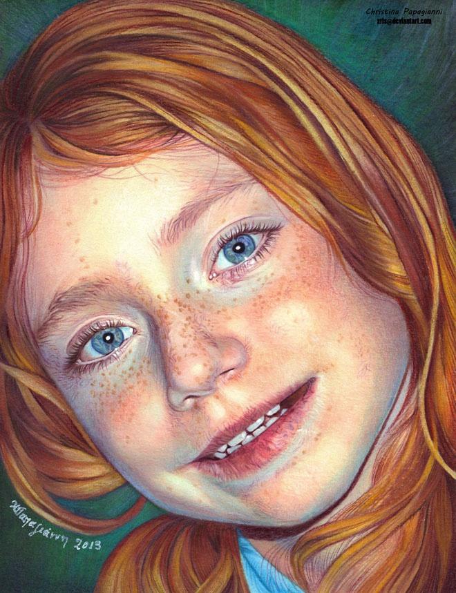 Рыжеволосая девочка с веснушками